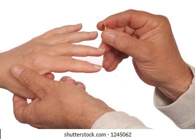 Man puts wedding ring on woman's finger