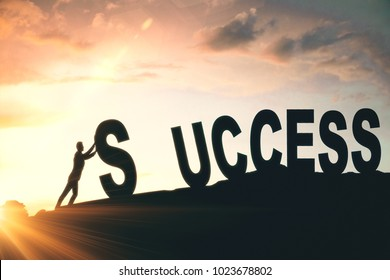 Man putting up abstract creative success word on sunlit sky background. Hard work and successful concept