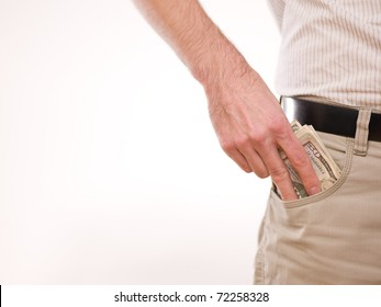 A man putting american money in his pants pocket