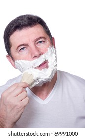 man putting beard foam