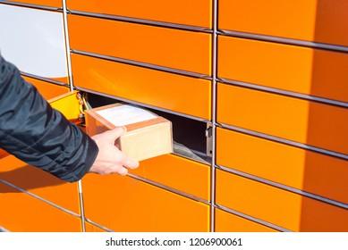 Man putting box to parcel machine