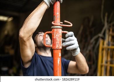man putting construction prop on door