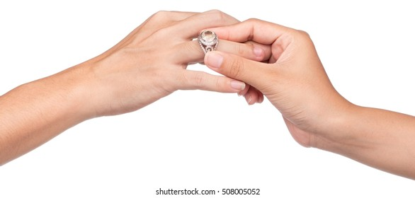 Man putting engagement ring on woman hand isolate on white background