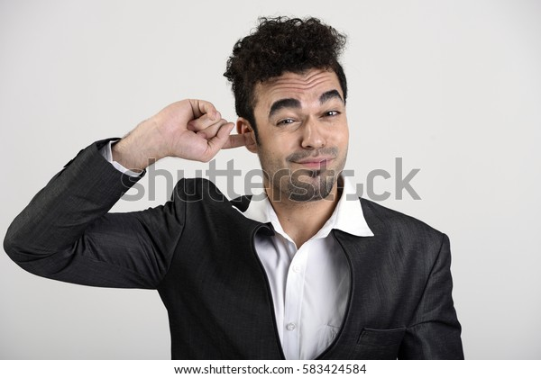 Man putting finger in ear to itch