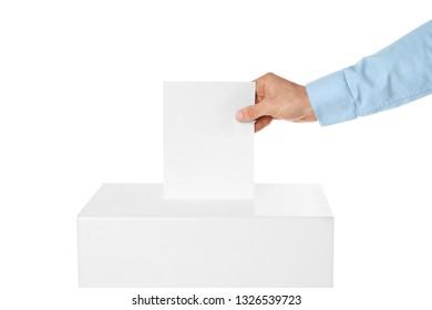 Man putting his vote into ballot box on white background, closeup