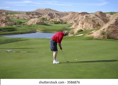 Man putting on beautiful golf course (Wolf Creek Golf Course in Mesquite, Nevada)