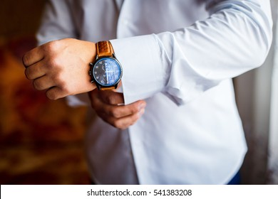 A man putting on watch