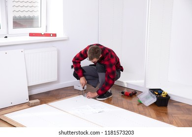 Man putting together  furniture