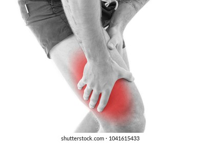 Man with quadriceps pain over white background
