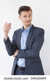 Man with Questioning Expression and Glass of Water