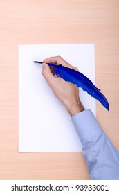 Man with quill writing