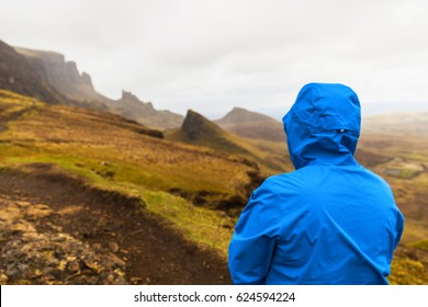 Man in rain jacket at Quiraing, Isle of Skye