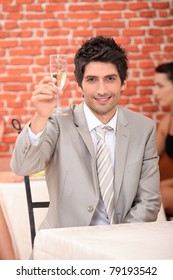 Man raising glass of champagne