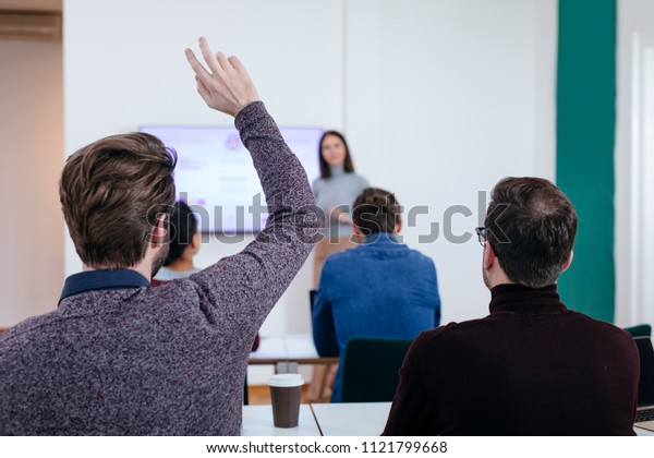 Man Raising Hand in Presentation