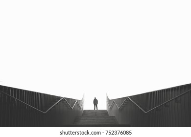 man raising stairs minimal architecture