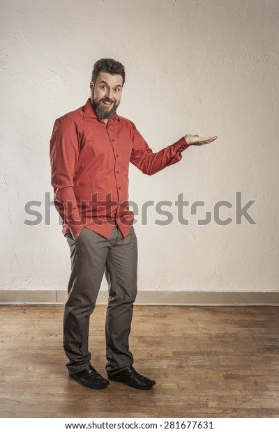 Man in rded shirt looking on his open hand
