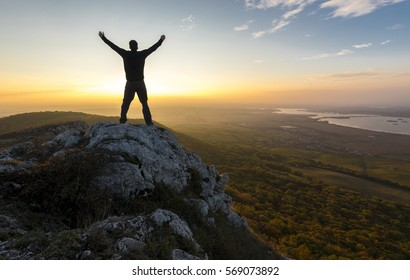 Man reached the top of the mountain