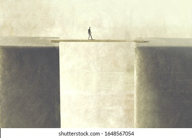 man reaching the other side crossing bridge