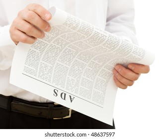 Man reading ads from the paper - isolated, closeup