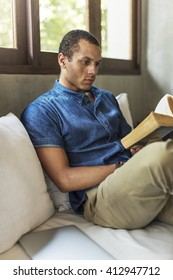 Man Reading Book Concentration Sitting Concept
