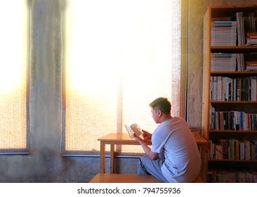 man reading book .slow life concept