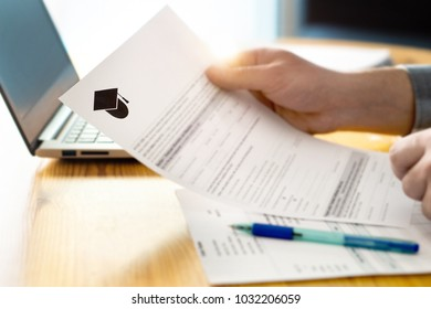 Man reading college or university application or document from school. College acceptance letter or student loan paper. Applicant filling form or planning studies.