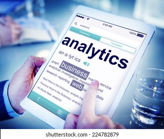 Man Reading the Definition of Analytics