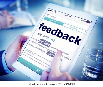 Man Reading the Definition of Feedback