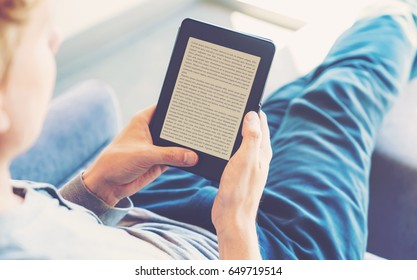 Man reading an e-book on digital tablet device