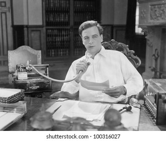 Man reading into Dictaphone