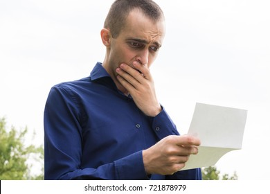 man reading letter and upset, bad news, mail