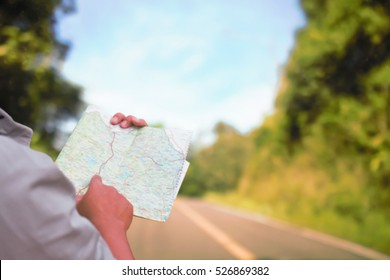 Man reading map soft blur for travel.