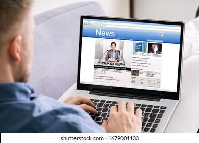 Man Reading News Website On Computer Screen