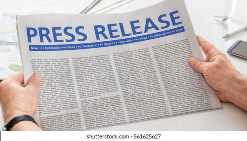 Man reading newspaper with the headline Press Release