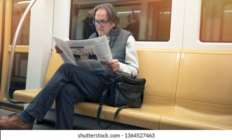 Man reading newspaper in the metro train