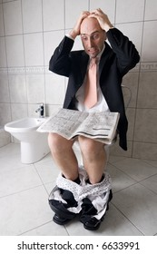 Man reading newspaper on toilet, expressing surprise at what he is reading