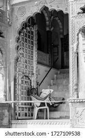 A man reads newspaper at Pushkar Camel Fair, Pushkar, Rajasthan / India - November 9,2019