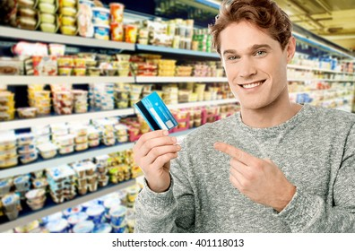 Man ready to buy household items in supermarket