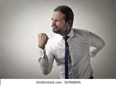 Man ready to fight in white shirt