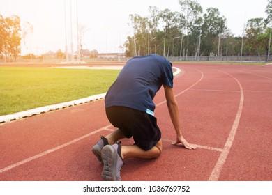 Man ready start run in track