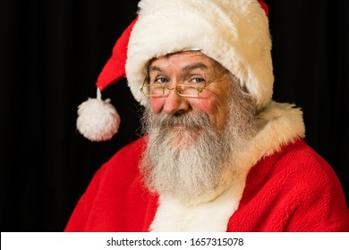 Man with real beard in Santa Claus dress