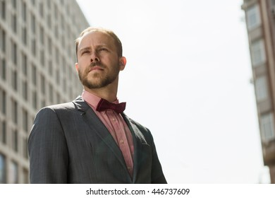 Man realtor standing at high building background