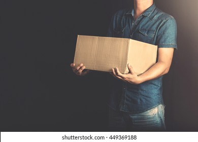 man receiving a delivery from post at home