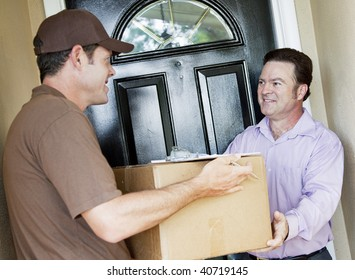 Man receiving a package delivery from a courier at his home.