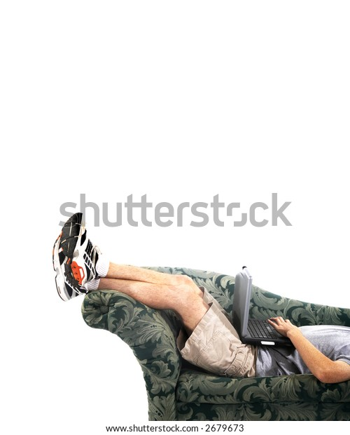 Man in a reclining position and typing on his laptop computer. Vertical photo on white background.