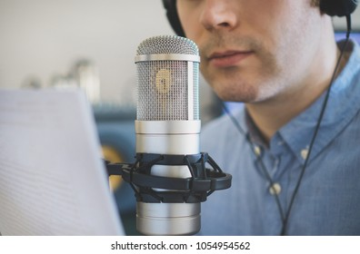 Man recording an advertisement on the radio station.