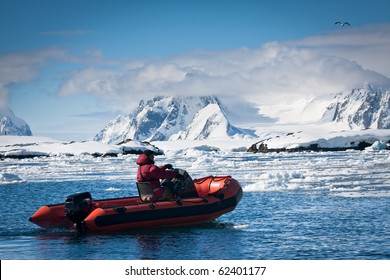 man in the red boat in Antarctic waters