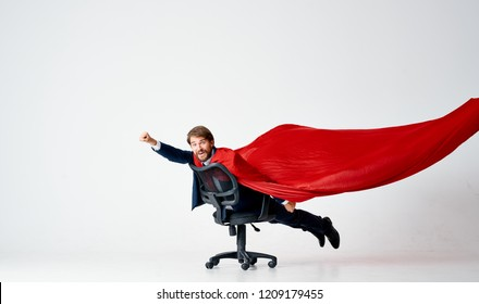 Man red cape office chair room
