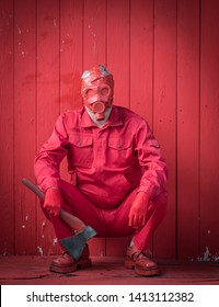 man in red clothes and red gas mask