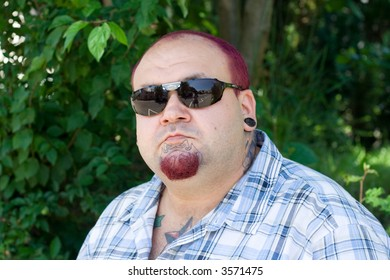 the man with red hair wearing sunglasses